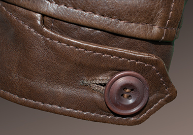 Courtney & Co. Cornbury 965 - 109 Brown corozo button on leather jacket (cuff detail)